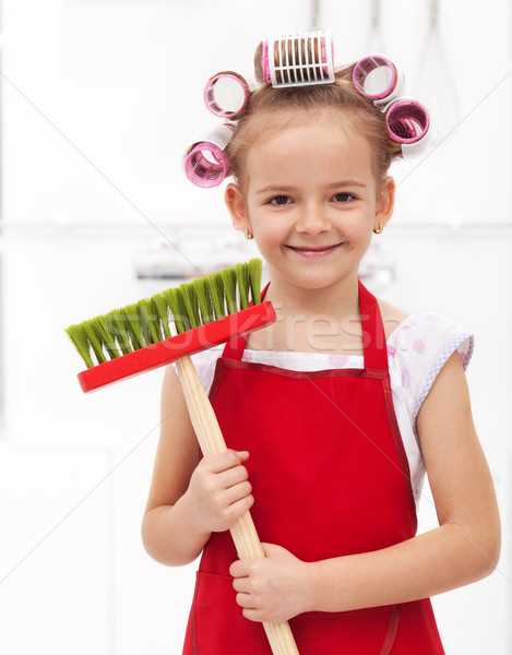 Little housekeeping fairy girl with large hair curls Stock photo © ilona75