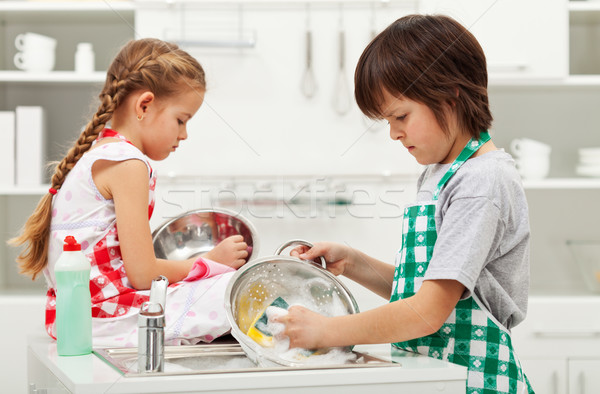Grumpy kids doing home chores - washing dishes Stock photo © ilona75
