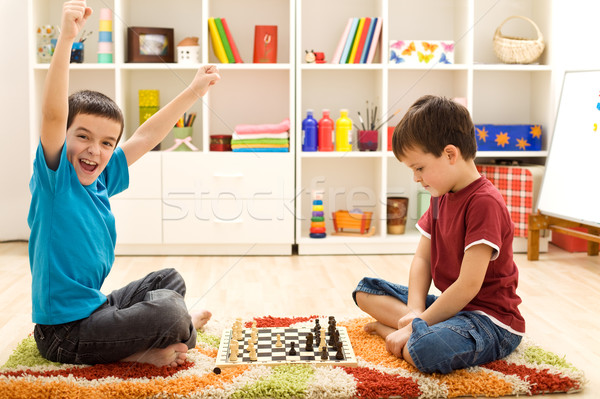 Kids playing chess - just captured a pawn Stock photo © ilona75