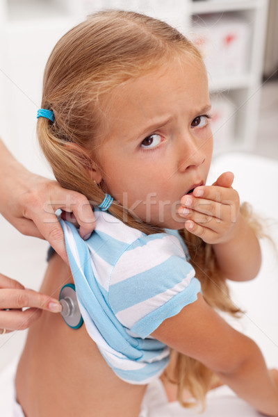 Coughing little girl at the doctors Stock photo © ilona75