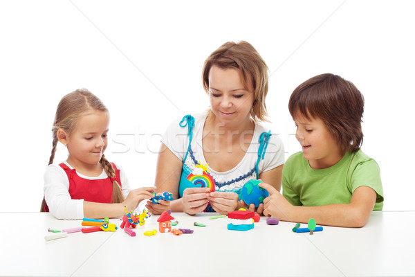 Woman and kids playing with colorful clay Stock photo © ilona75