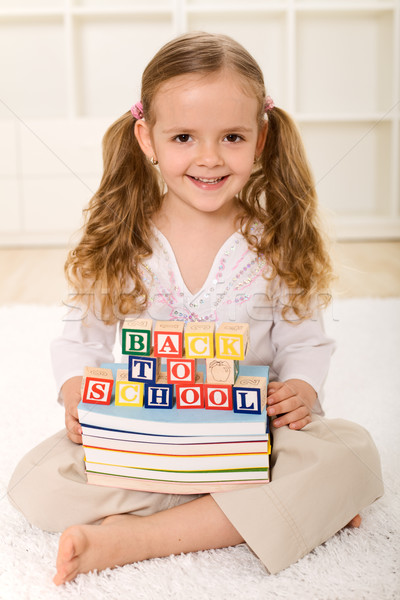 Stock photo: Happy little girl ready to go back to school