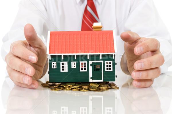 дома монетами бизнесмен рук Сток-фото © ilona75