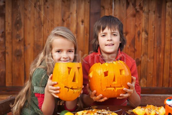 Kids showing their jack-o-lanterns Stock photo © ilona75