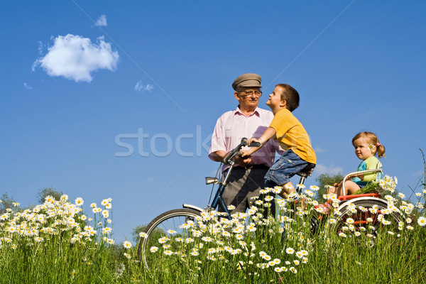 Bycycle ride with grandpa in the spring Stock photo © ilona75