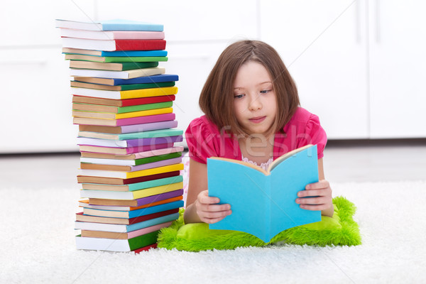 Young girl with lots of books Stock photo © ilona75