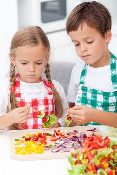 Kids preparing veggies on stick Stock photo © ilona75