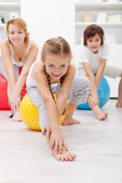 Jimnastik ev kadın çocuklar büyük egzersiz Stok fotoğraf © ilona75