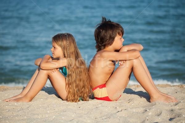 Stok fotoğraf: çocuklar · rahatlatıcı · plaj · erkek · kız · oturma