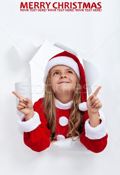 Heureux fille Noël pointant espace de copie Photo stock © ilona75