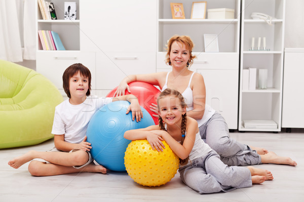 Woman and kids ready for gymnastic - sitting on the floor Stock photo © ilona75