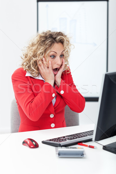 Oh no - shocked business woman in front of computer Stock photo © ilona75