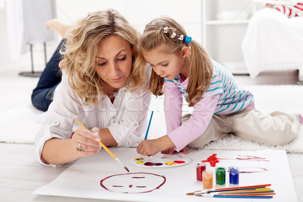 Little girl painting with her mother Stock photo © ilona75