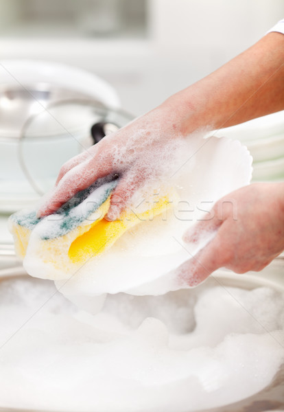 Washing the dishes - closeup on hands Stock photo © ilona75