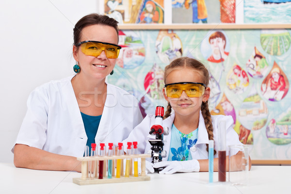 Stock photo: Teacher with young student at elementary science class