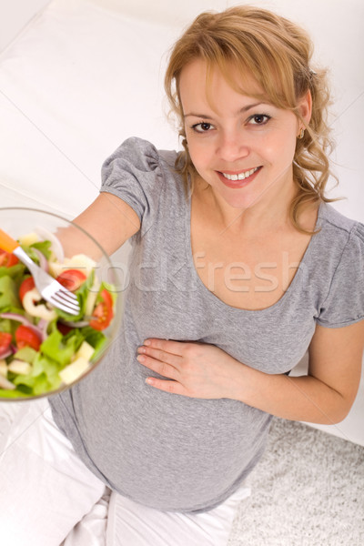 Pregnant woman holding a bowl of salad Stock photo © ilona75