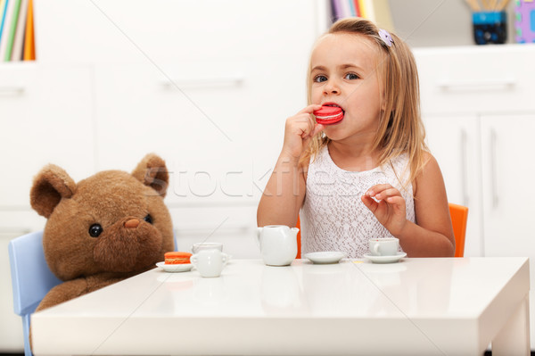 Little girl having a tea party with her toy bear Stock photo © ilona75