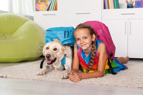 Young girl and her labrador dog ready for school Stock photo © ilona75