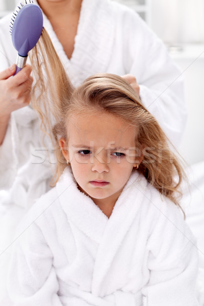 Combing and pulling hair - the price of  beauty Stock photo © ilona75
