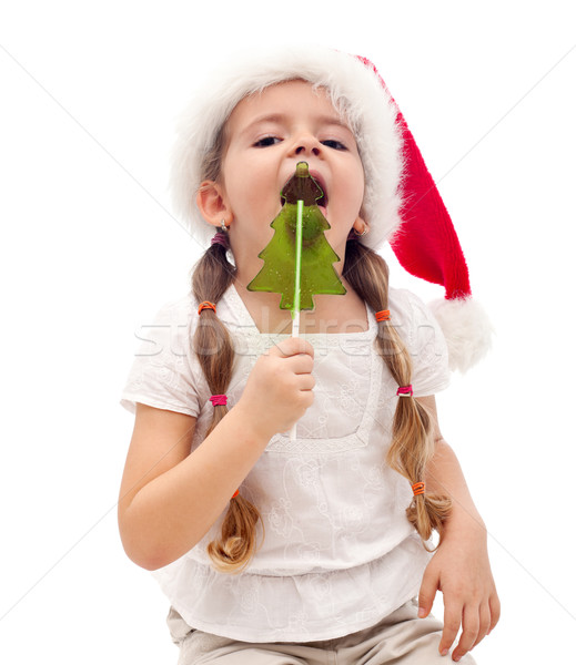 Petite fille arbre de noël bonbons occupés fille Photo stock © ilona75
