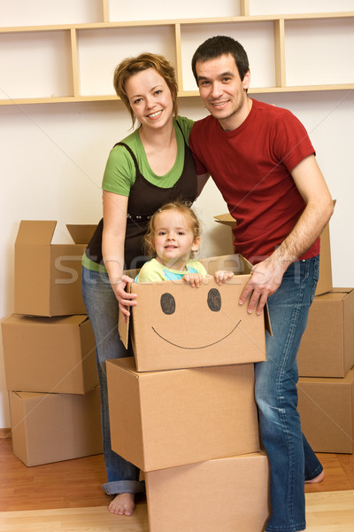 Happy family unpacking in a new home Stock photo © ilona75