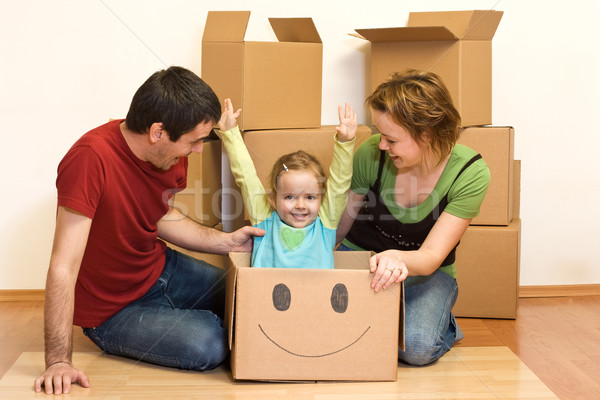 Happy family unpacking in their new home Stock photo © ilona75