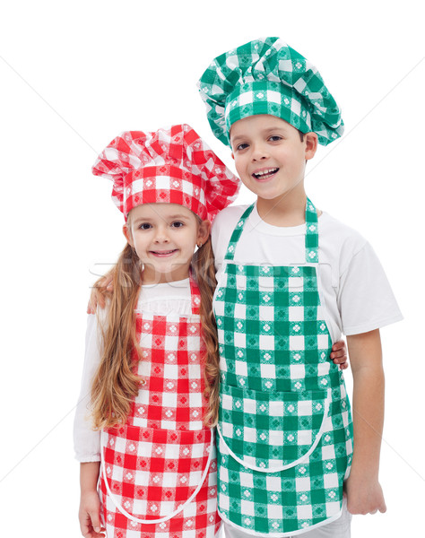 Happy chefs - boy and girl with aprons and hats Stock photo © ilona75