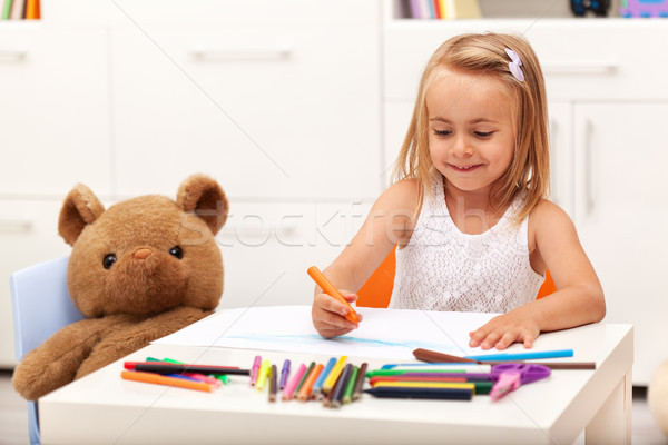 Little girl drawing with color pencils - sitting at the table Stock photo © ilona75