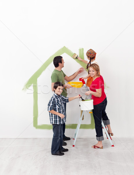 Happy family with kids redecorate their new home Stock photo © ilona75