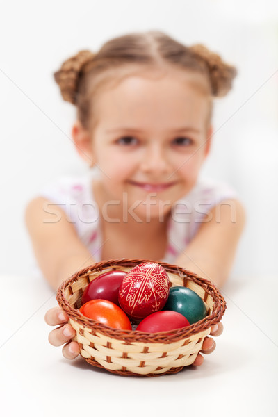 Little girl holding a basket with dyed and decorated easter eggs Stock photo © ilona75