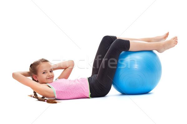 Genç kız oturmak büyük jimnastik top gülen Stok fotoğraf © ilona75