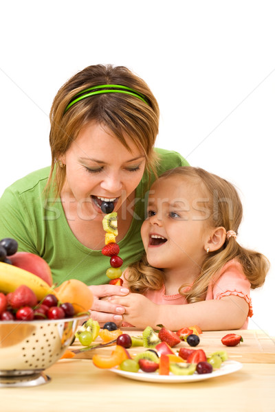 Little girl feeding her mother Stock photo © ilona75
