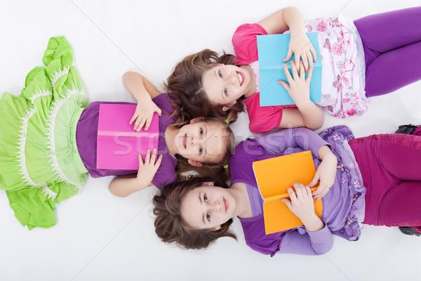 Girls reading afternoon Stock photo © ilona75