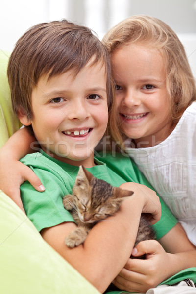 Happy kids with their new pet - a little kitten Stock photo © ilona75