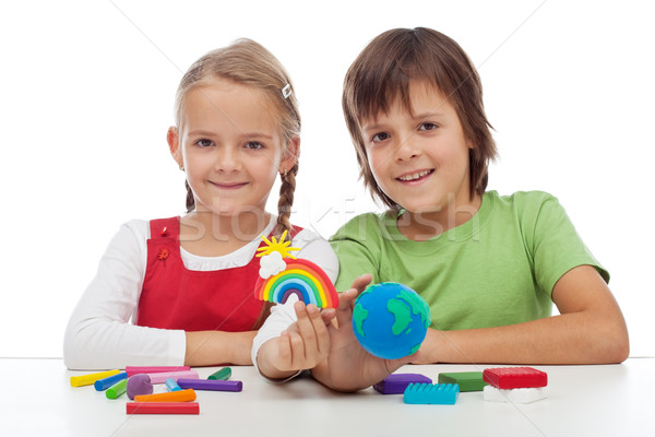Kids making ecology theme clay figures Stock photo © ilona75