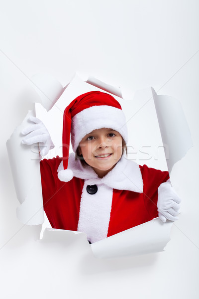 Opening the holidays season - boy looking through jagged edge ho Stock photo © ilona75