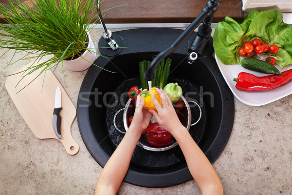 Child hands washing vegetables at the kitchen sink - a bellpeppe Stock photo © ilona75