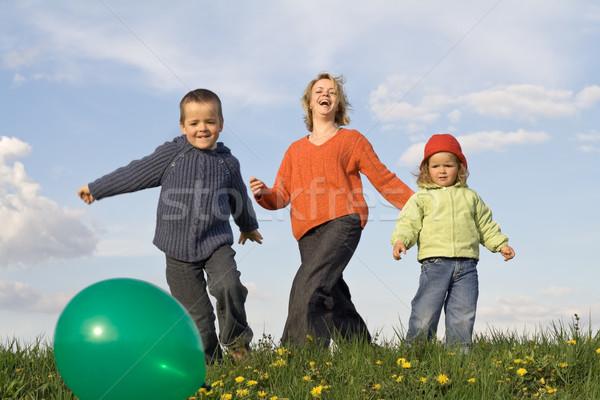 Active happy people outdoors - slight motion blur Stock photo © ilona75