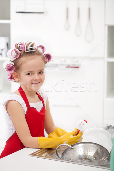 Little girl with big curls doing the dishes Stock photo © ilona75