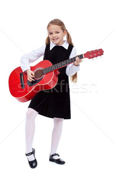 Сток-фото: девочку · черное · платье · красный · гитаре · обучения