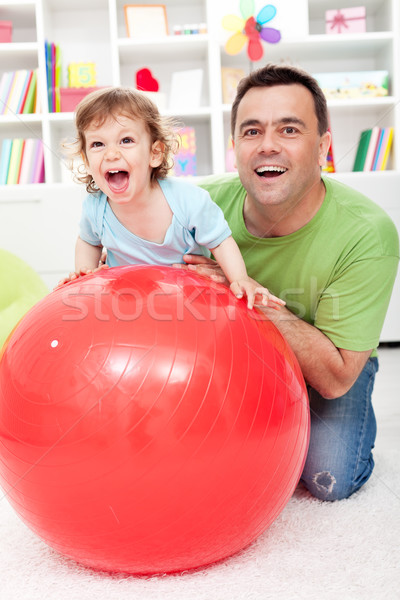 Toddler boy having fun with his father Stock photo © ilona75