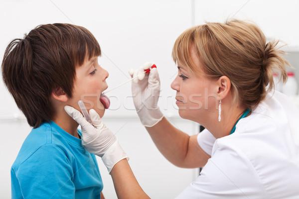 Health professional taking saliva sample from little boy Stock photo © ilona75