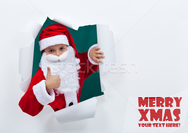 Santa popping out of torn edges hole with thumbs up sign Stock photo © ilona75