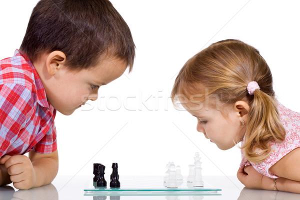 Ninos jugando ajedrez grave nina diversión nino Foto stock © ilona75