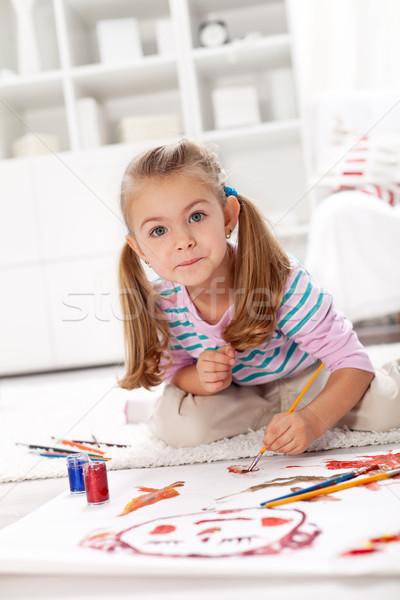 Little artist girl painting Stock photo © ilona75
