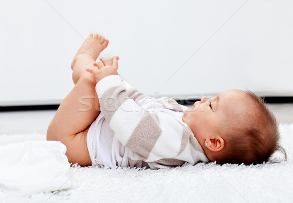 Baby girl waiting for a new diaper Stock photo © ilona75