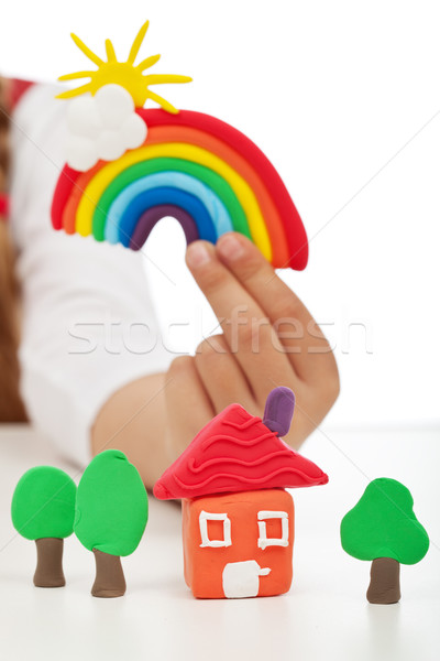 Clean environment concept - child hand with colorful clay figure Stock photo © ilona75