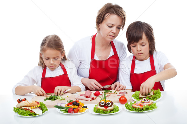 Kids and their mother preapring the party sandwiches Stock photo © ilona75