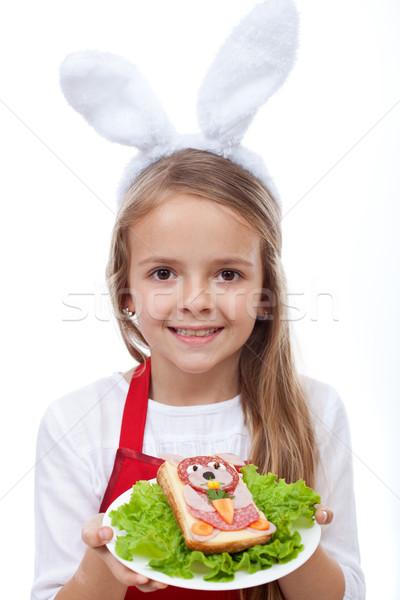 Bunny chef presenting her masterpiece - a rabbit shaped sandwich Stock photo © ilona75