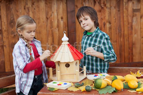 Kids painting a bird house Stock photo © ilona75